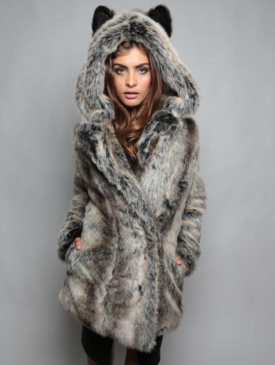 A woman made ugly for wearing a wolf coat jacket.