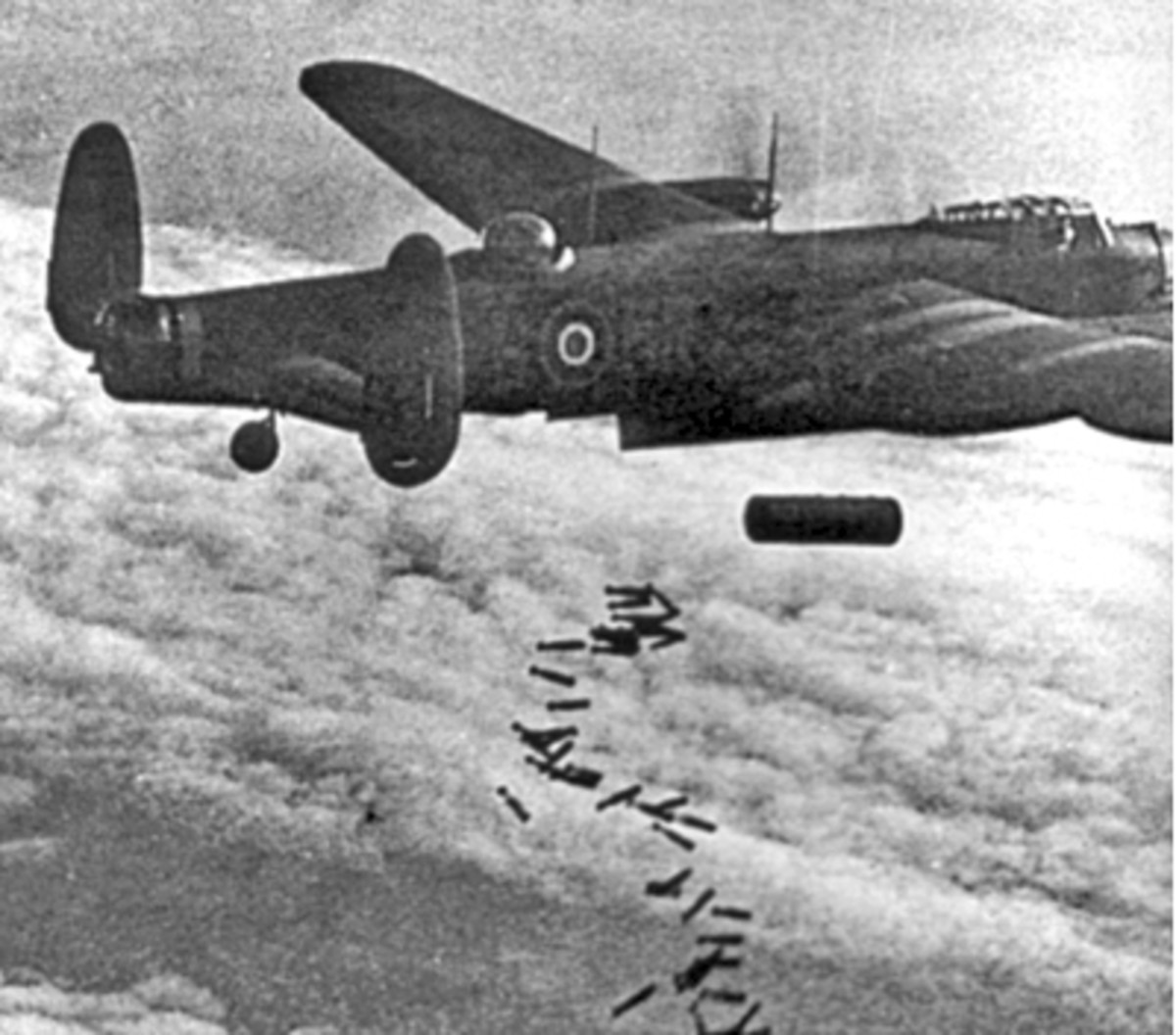 A Lancaster bomber drops a combination of incendiary and high-explosive weapons.
