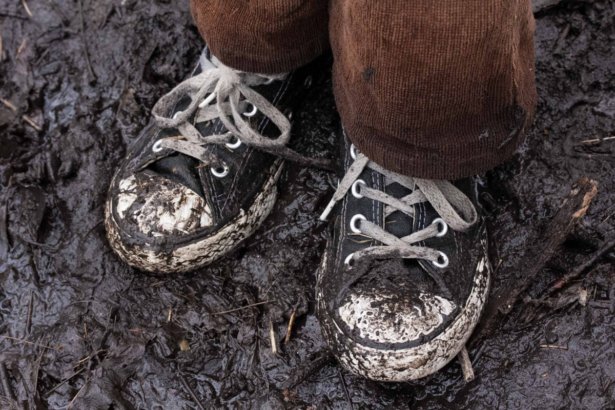 Muddy sneakers led to Christopher Green's arrest.