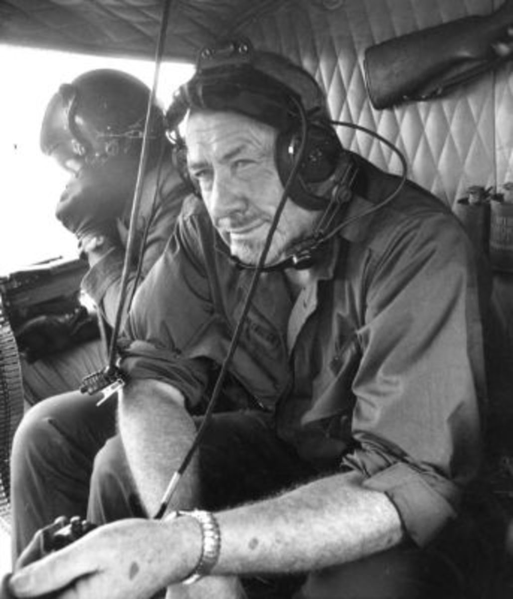 John Steinbeck as a Vietnam War correspondent, aboard a US Army Iroquois helicopter.  My folklore is better than your folklore.