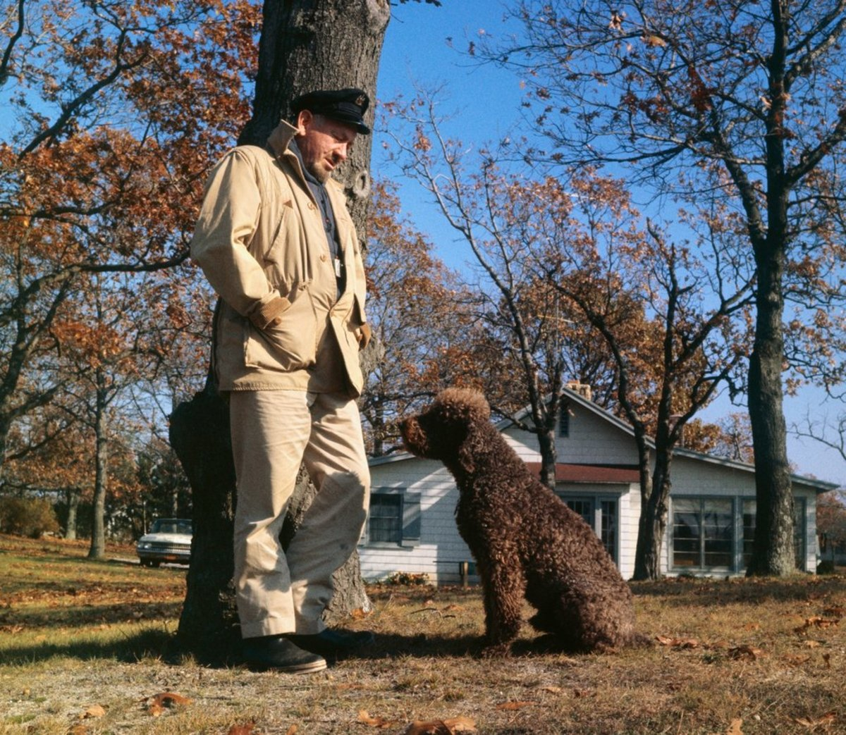 Steinbeck with Charley at Sag Harbor, discussing canine folklore.