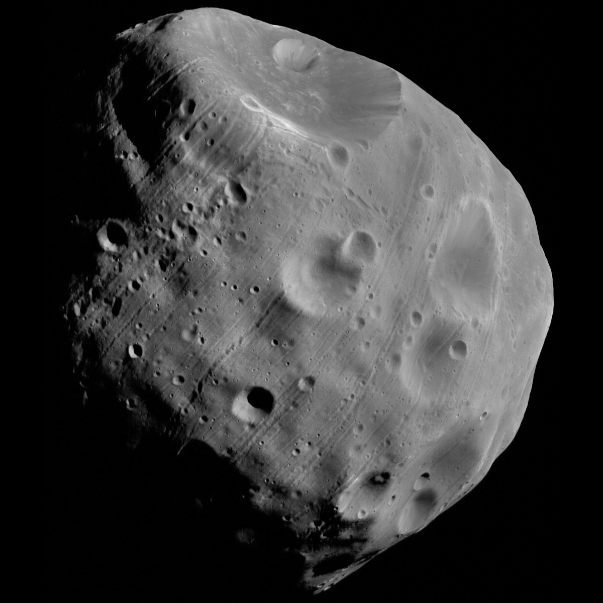 Phobos has a large crater (Stickney) on its surface.
