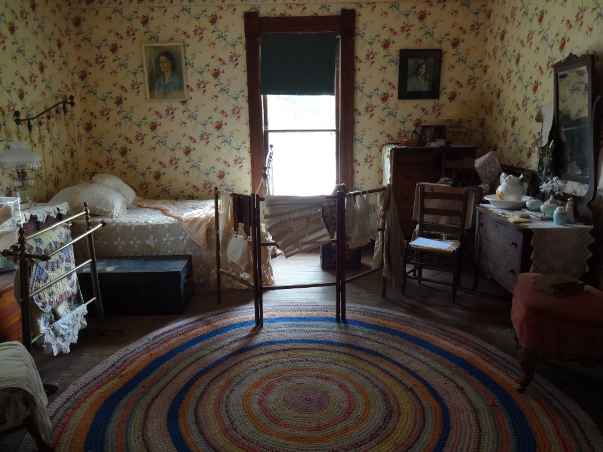 Room and board provided supplemental income for the household. Washbasins, rag rugs, hand made quilts, all products of the time.