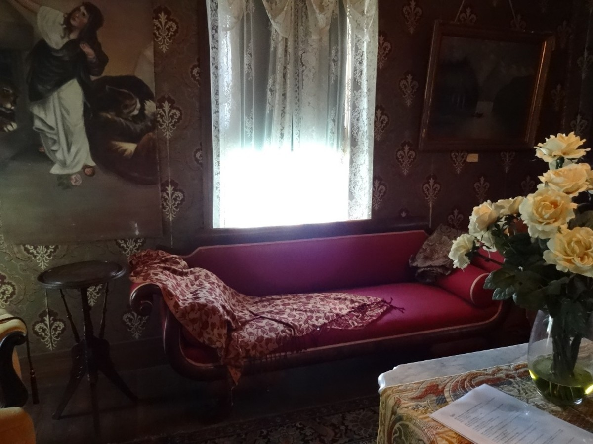 Velvet upholstery, lace curtains and dark rooms