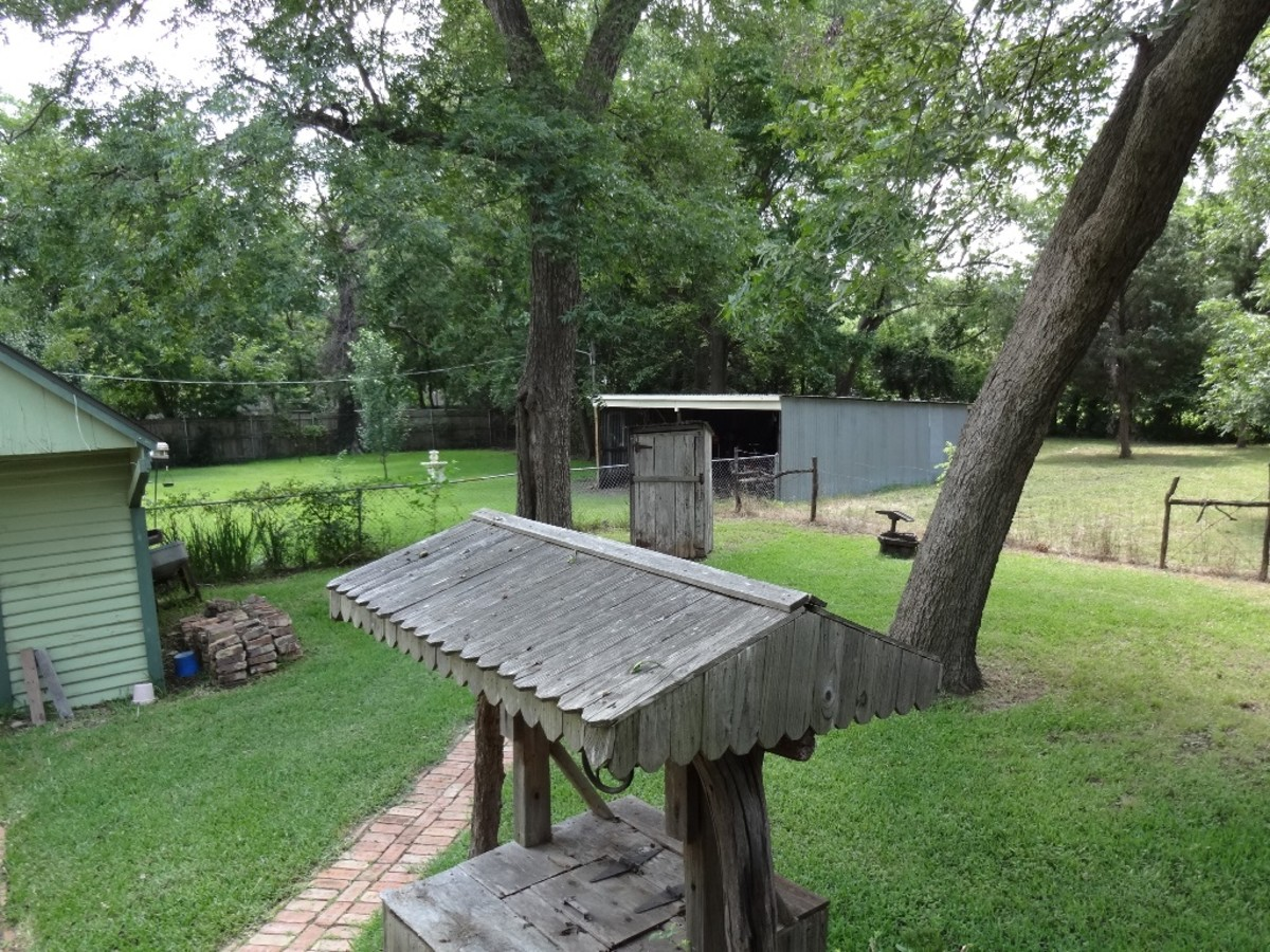 The covered well along the path is on the way to the outhouse which was used before indoor plumbing was installed.