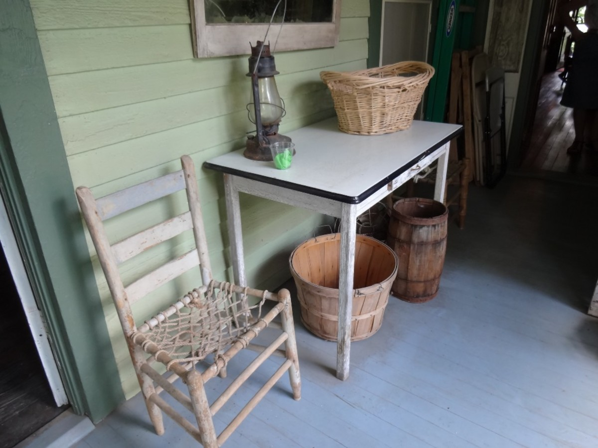 A small screened porch leads to the backyard  well and the path to the outhouse.