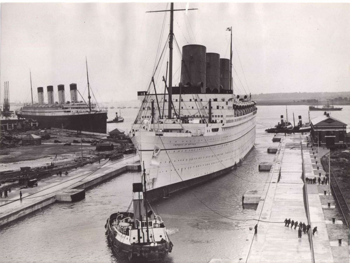 1930s. RMS Olympic behind RMS Empress of Britain, one of the newer, larger, more modern liners Titanic's sister began loosing money to by this time.