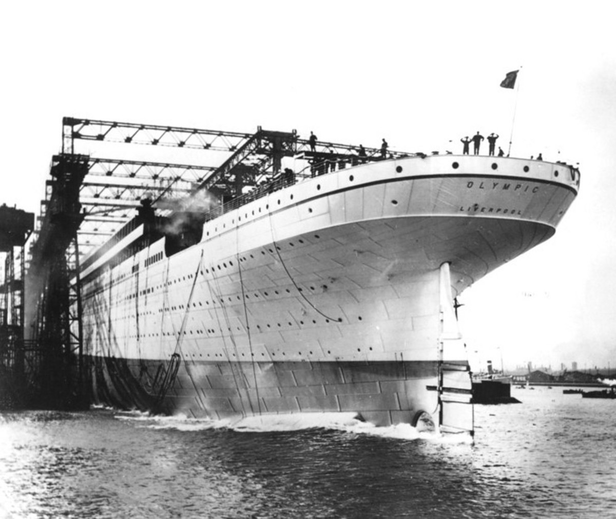 The launch of Olympic. Traditional with lead ships of a class, the hull was painted a light grey so that her features would stand out in photographs.