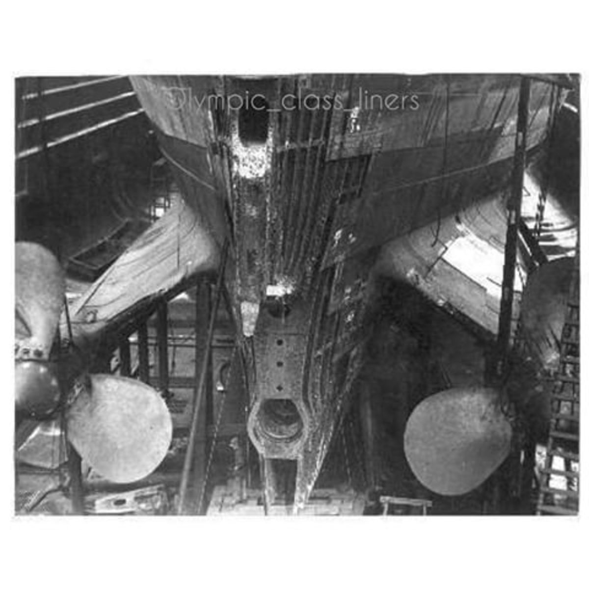 This photo shows, Olympic's stern post removed for replacement. The task required the removal of the ship's rudder and center propellor.