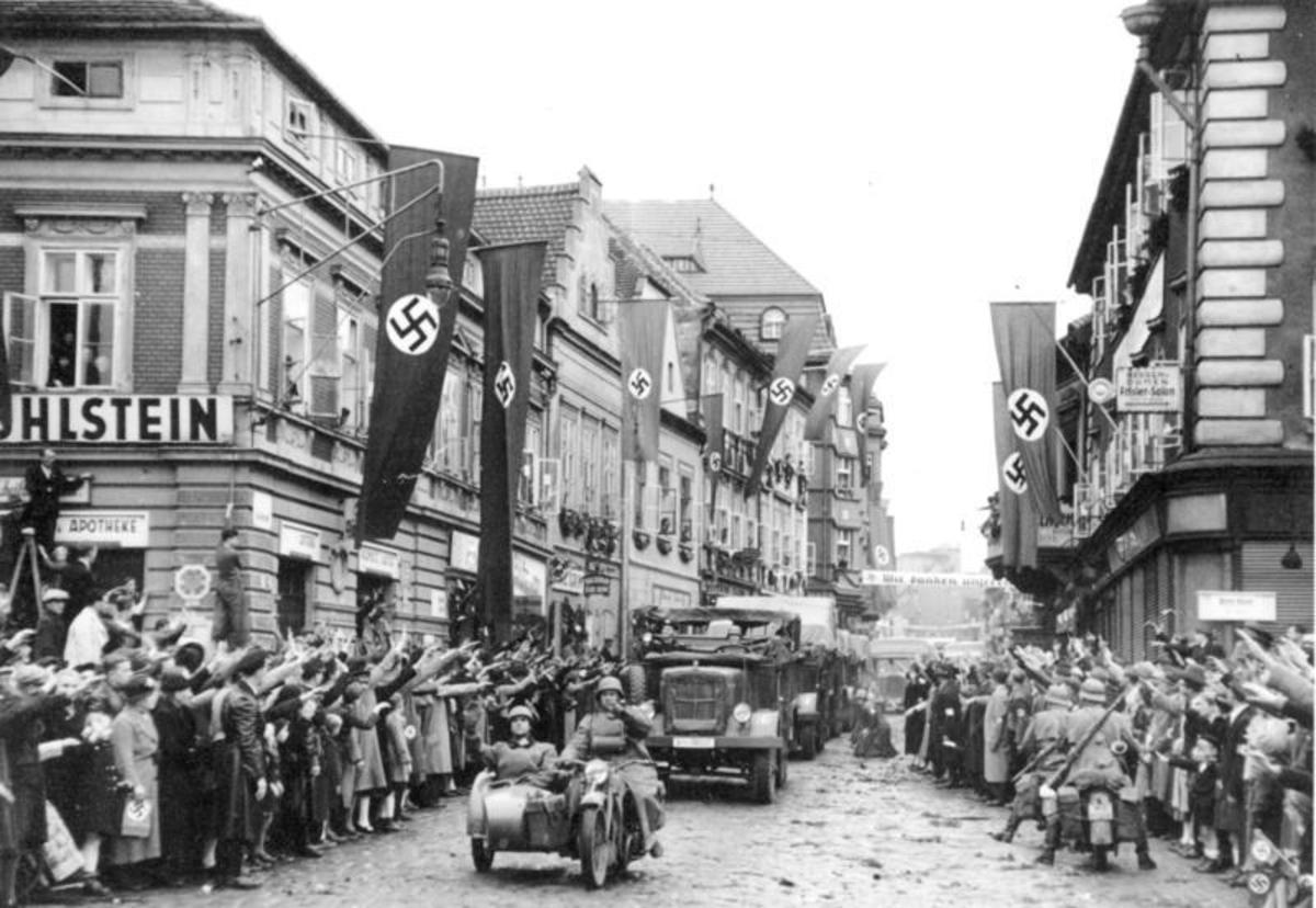 German troops are welcomed into Czechoslovakia in 1938.