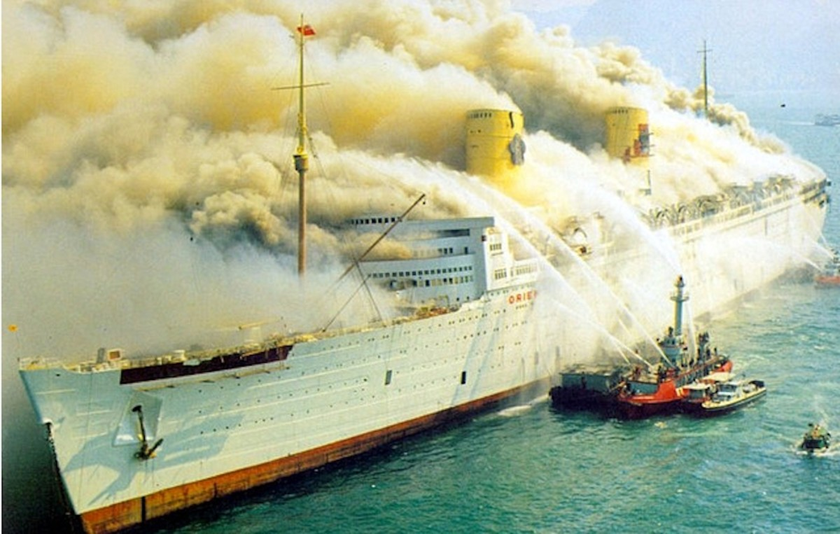 The RMS Queen Elizabeth on fire.