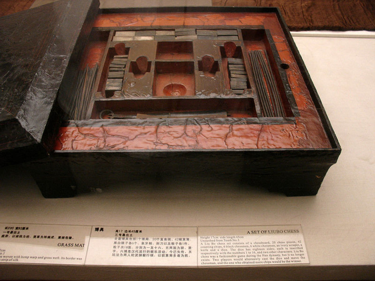 A lacquered Chinese liubo board game set excavated from Tomb No. 3 of Mawangdui, Changsha, Hunan province, China, c. 2nd century BCE. The set featured a lacquered game box, lacquered game board, 12 cuboid ivory pieces, 20 ivory game pieces, 30 rod-sh
