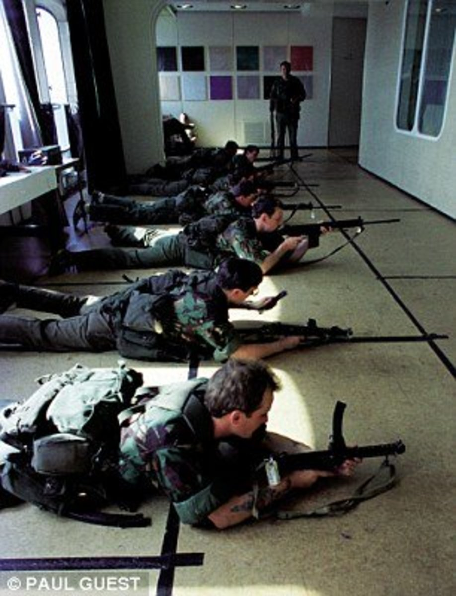 Troops train in one of QE2's converted lounges. Notice how the carpet has been covered over with hardboard.
