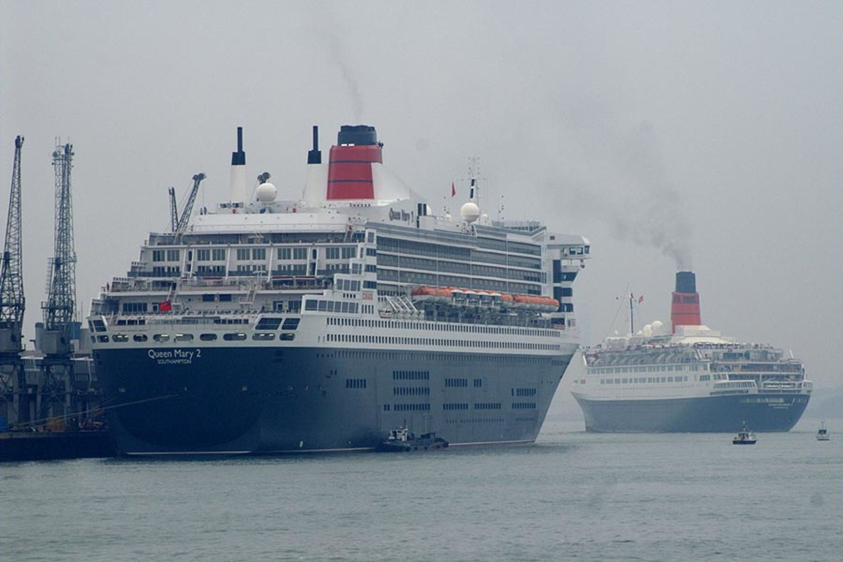 The QM2 and QE2. The ships would meet several times from 2004-2008 until QE2's retirement.