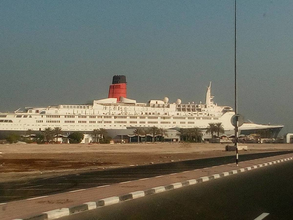 One of the most recent photos of the QE2 taken in August 2016 showing the missing lifeboats and davits.