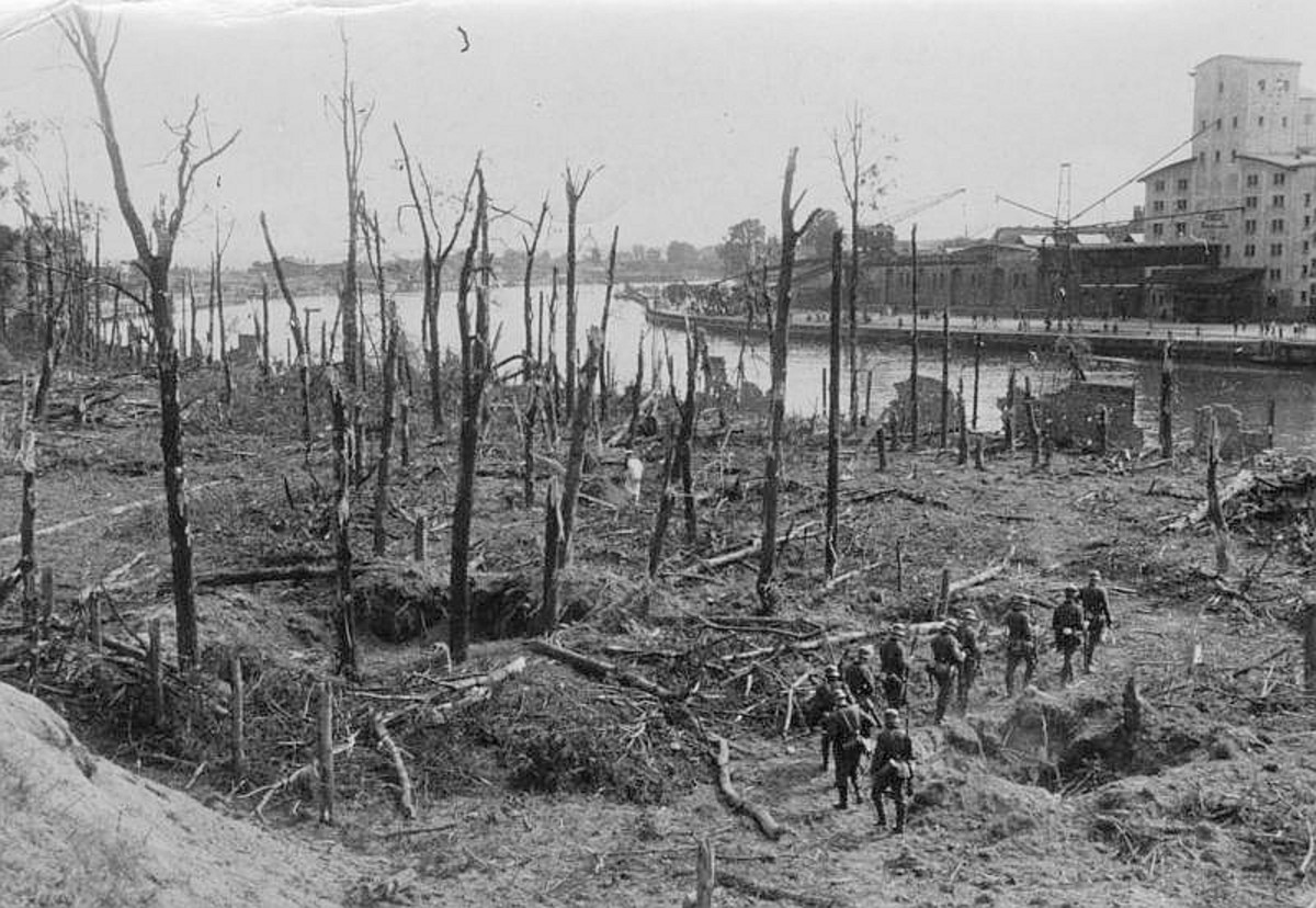 German troops in the ruined forest of Westerplatte the day after it fell. In the distance (southwest) is the channel where the battleship Schleswig-Holstein bombarded Westerplatte. September 8, 1939.