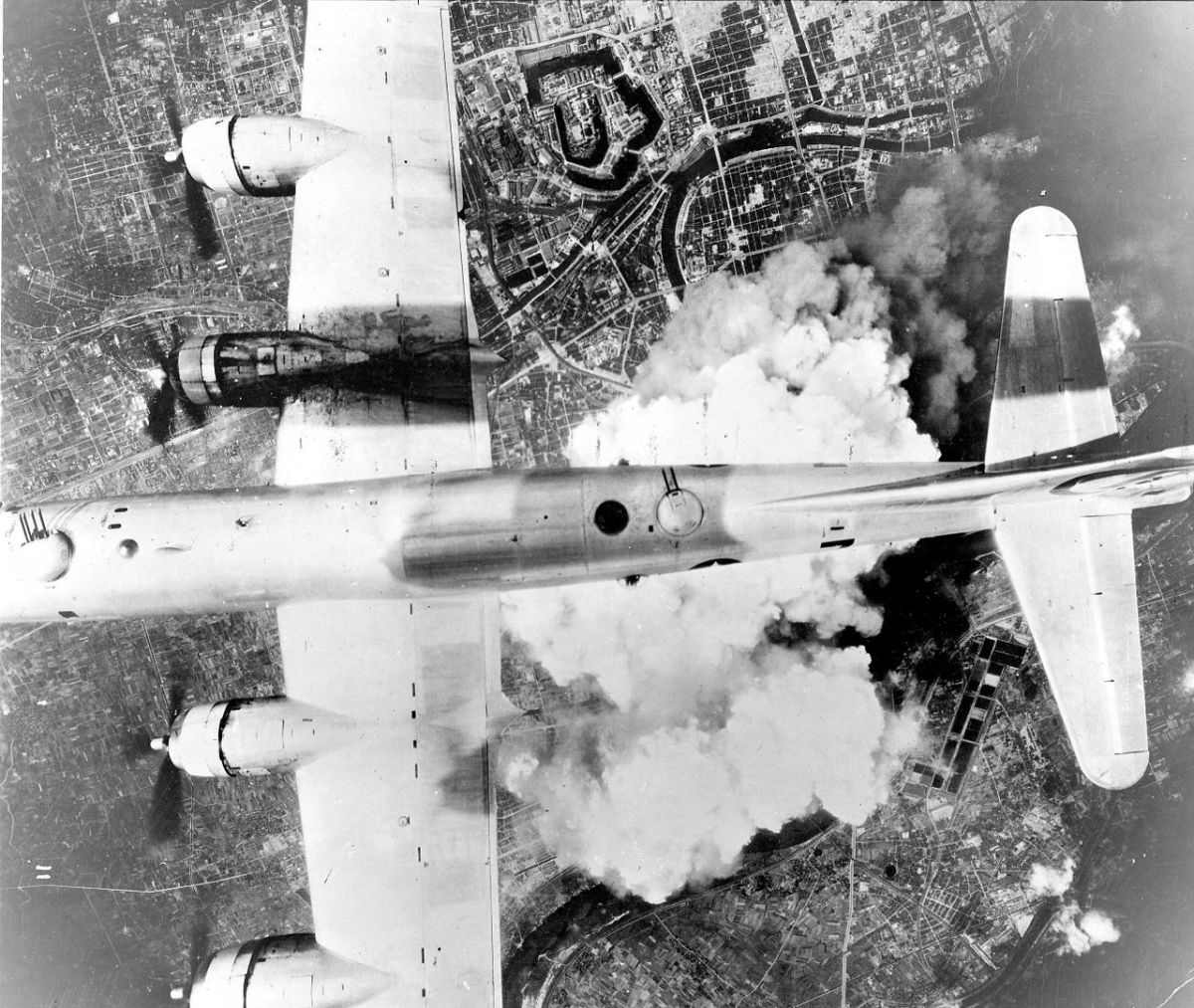 A B-29 dropping incendiary bombs on a Japanese city 1945.