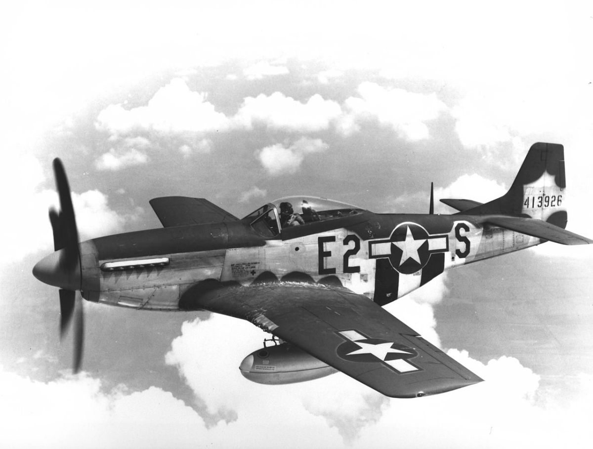 The P-51 with its drop tanks which could be jettisoned in an emergency. P-51 could fly over 600 miles from its British bases with drop tanks.