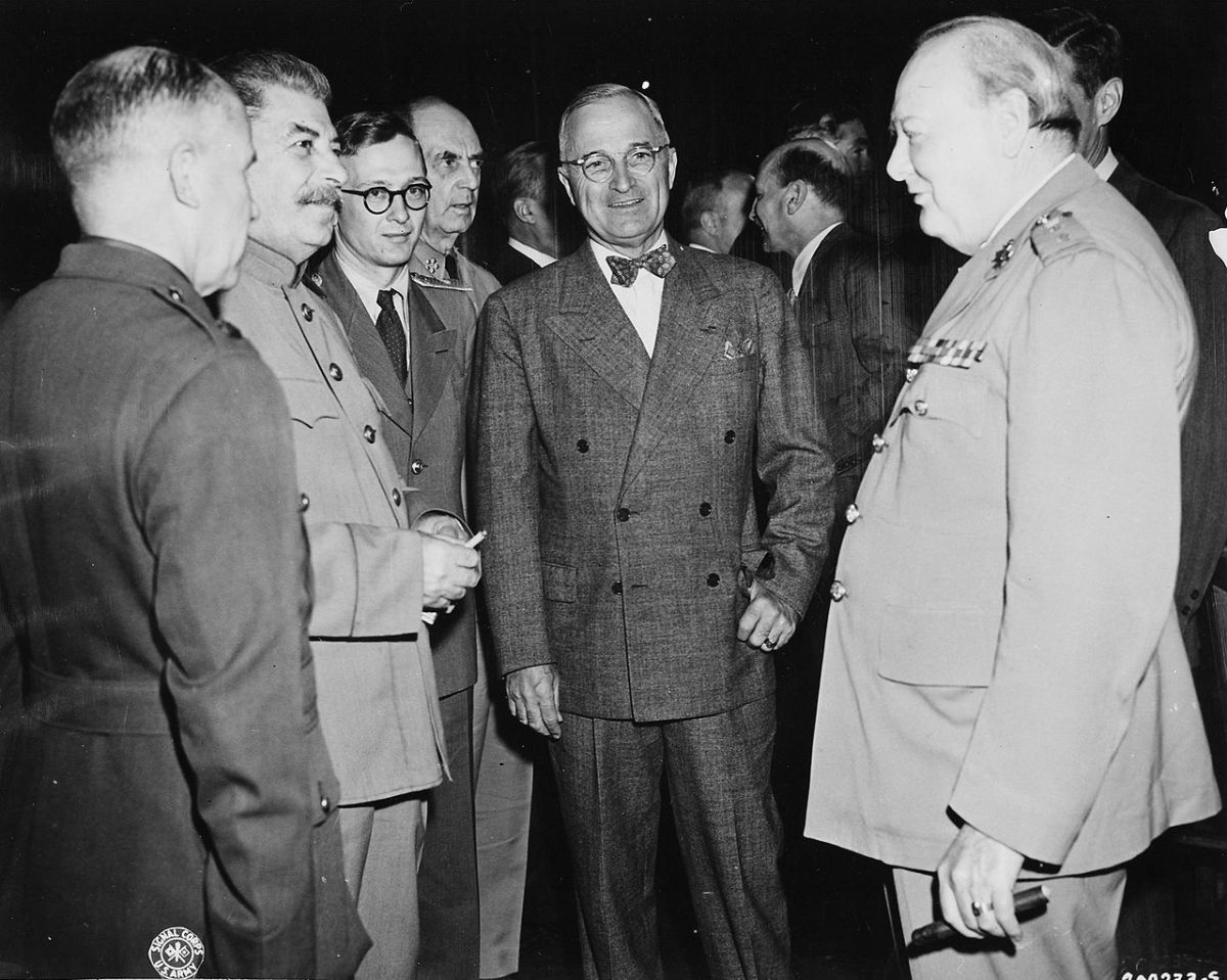 Harry S. Truman center of picture at Potsdam July 1945 with Stalin and Churchill. Truman would give the green light for the Atomic Bomb attack on Hiroshima and Nagasaki.