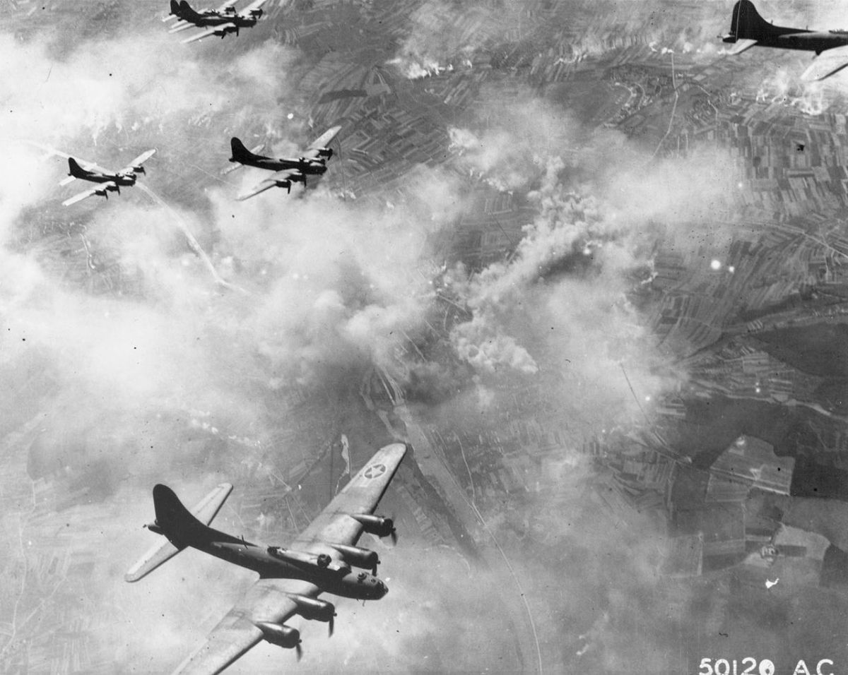 Boeing B-17Fs in formation over Schweinfurt Germany August the 17th 1943. Note the smoke on the ground from the bomb run.