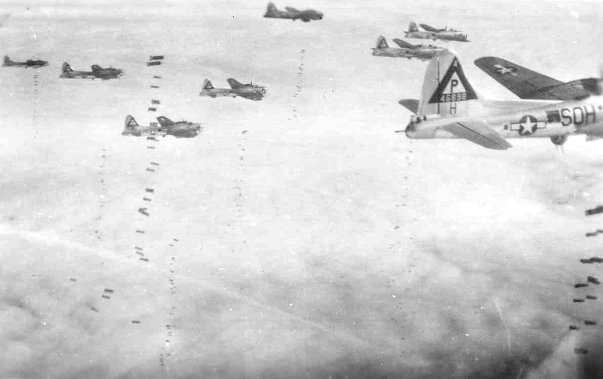 B-17s on a bombing run note the falling bombs.