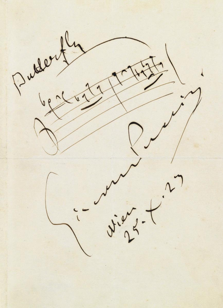 Notation of the opening of the aria 'One Fine Day' with Puccini's signature.