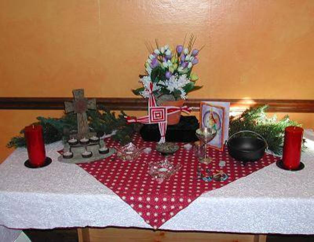 An altar for Imbolc. Brigith's cross is center with a picture of the saint to the right and the Christian cross on the left