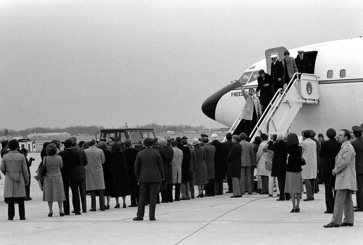 Freed Americans held hostage by Iran disembark Freedom One, an Air Force VC-137 Stratoliner aircraft, upon their arrival at the base. January 27, 1981.