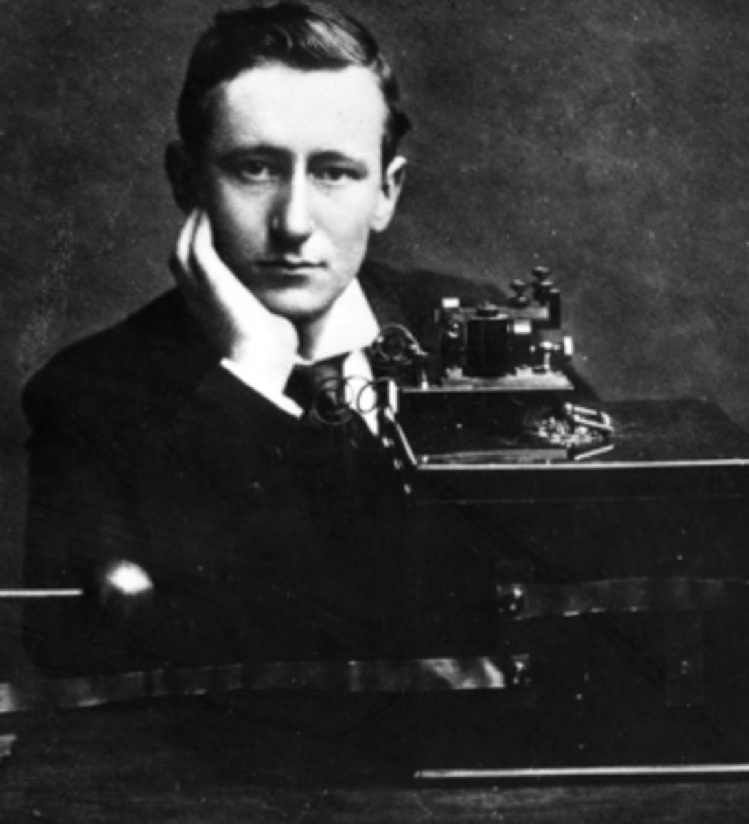 Guglielmo Marconi with his wireless telegraphy device.