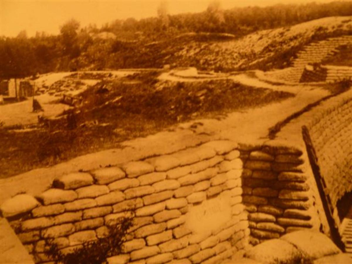 Photograph of an old postcard showing a section of restored Canadian trenches at Vimy