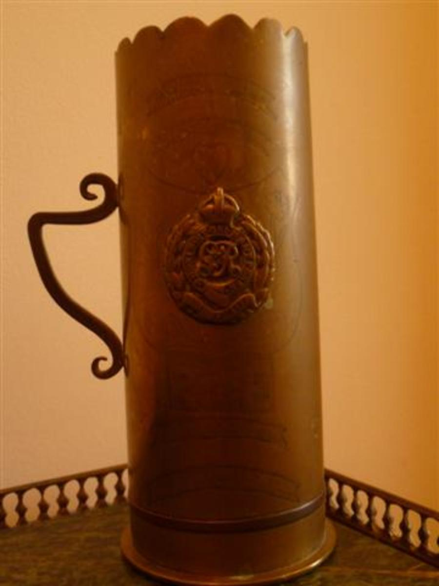 A piece of trench art made from a shell casing. It is inscribed Vimy 1917 and bears the crest of the Royal Engineers.