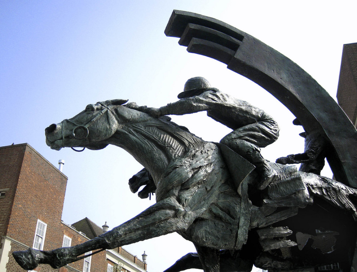 Outside the Ebbisham Centre. Bronze sculpture by Judy Boyt, 2001. It is a portrait of two racehorses, Diomed, the winner of the first Derby in 1780, and on the 2001 winner, Galileo.