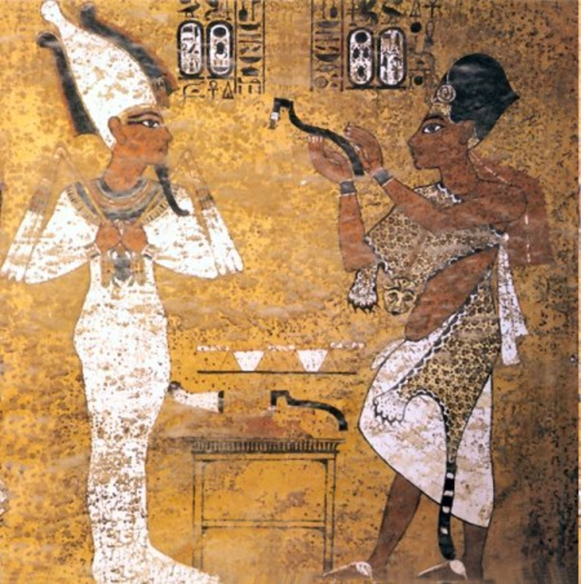 Ay performing the opening of the mouth ritual on Tutankhamun. Tutankhamun is shown here as a fully-fledged Osiris.