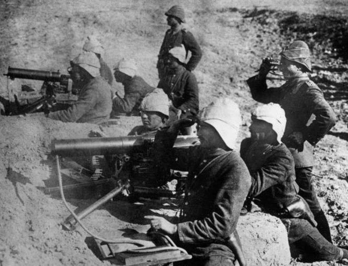 Turkish troops occupy a machine gun position with German officers.