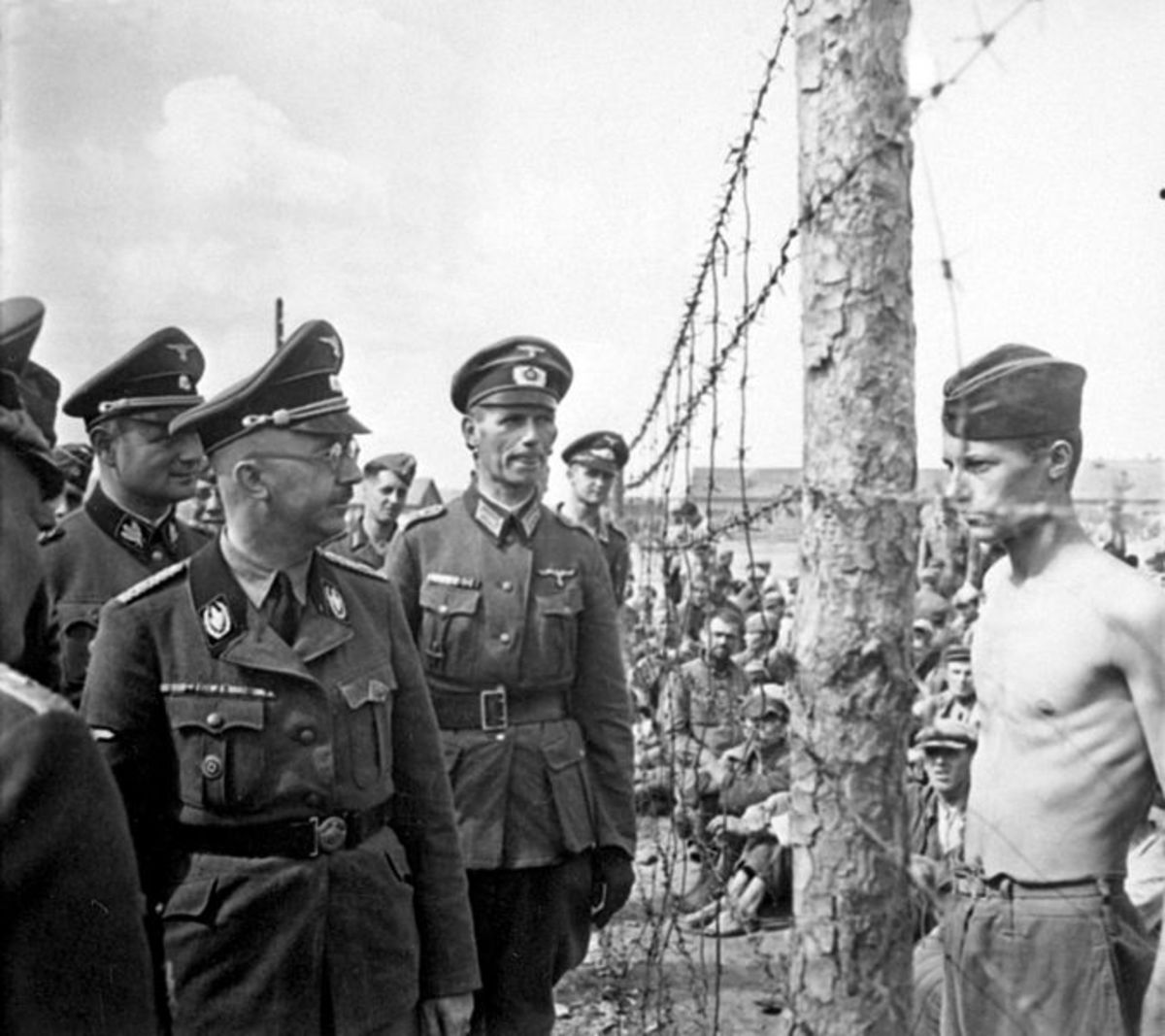 This image is believed to be Horace Greasley confronting Himmler and asking for better food. He took his shirt off to show how scrawny he was. The food did not improve.