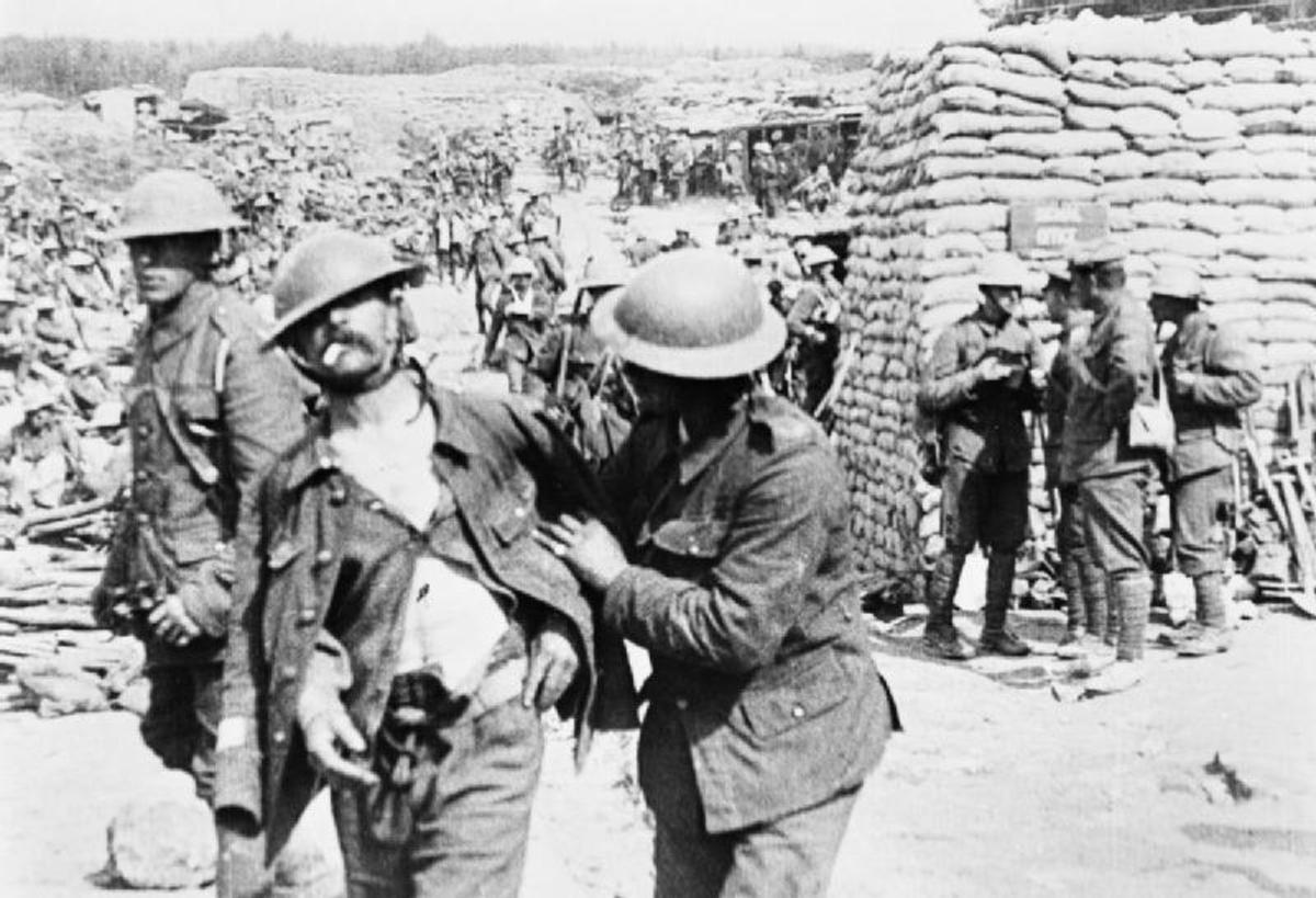 A shell-shocked British soldier receives help.