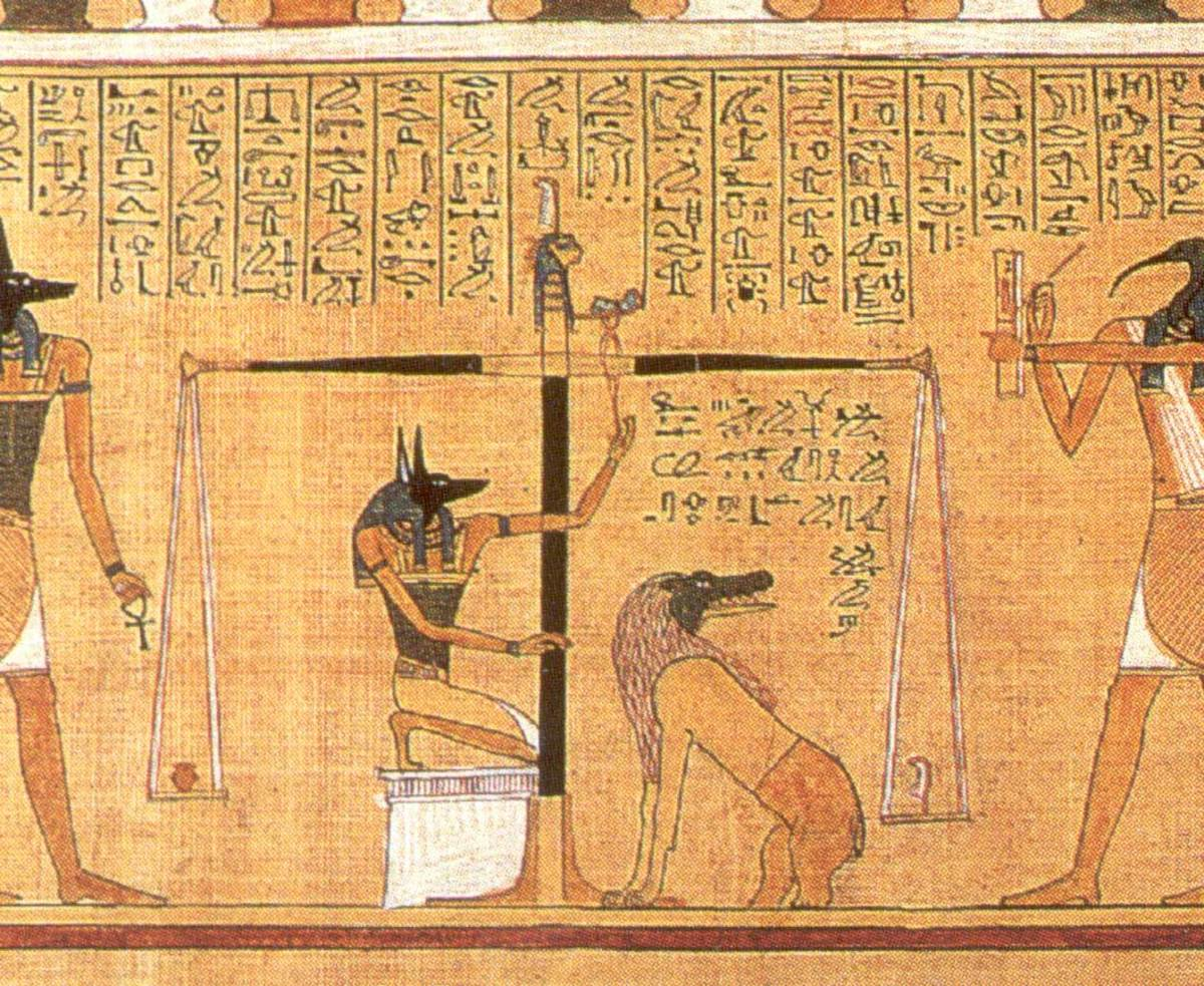 The Weighing of the Heart. See Ammit waiting patiently to devour the unworthy hearts?