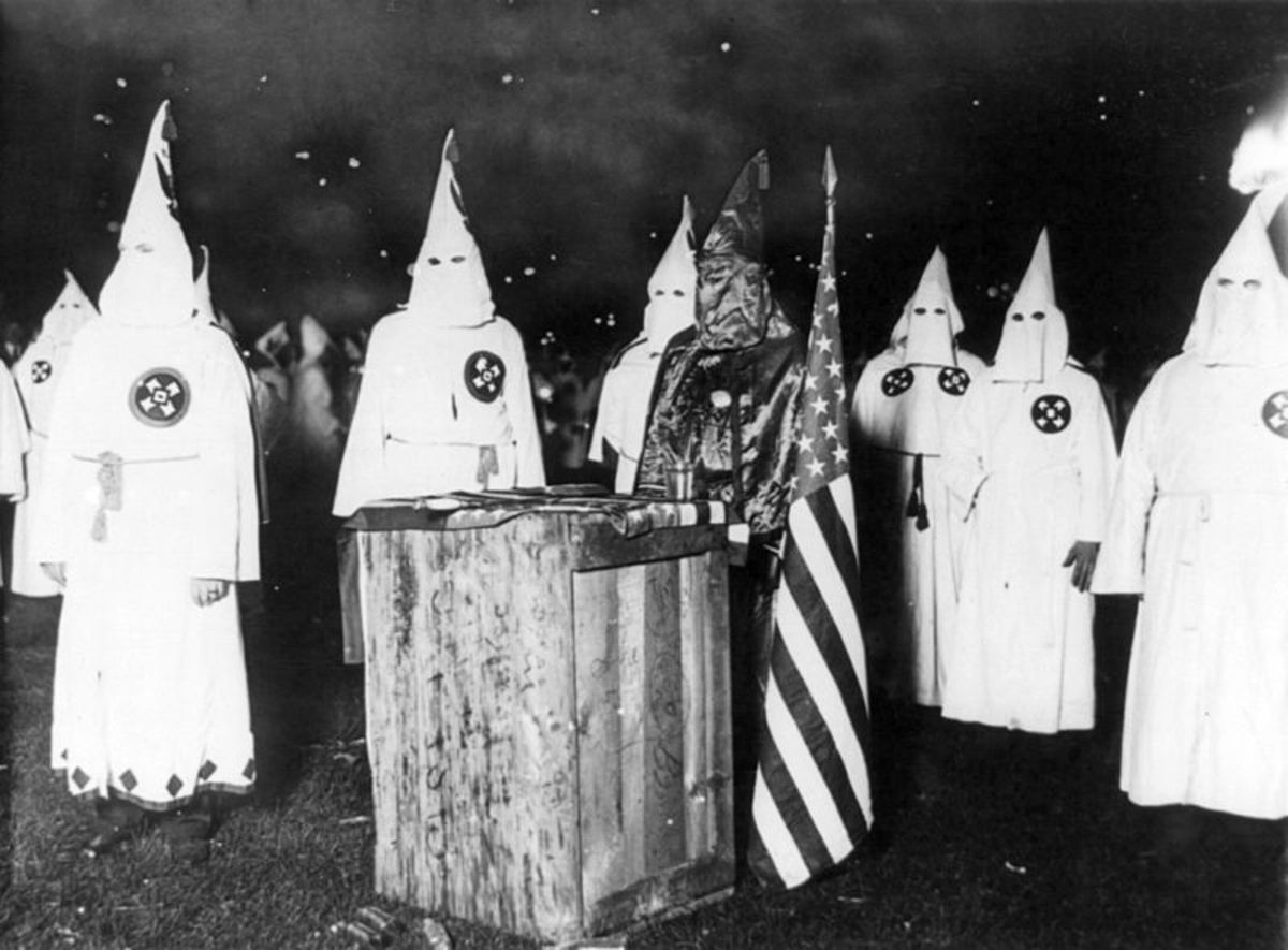 A Ku Klux Klan night rally in Chicago, around 1920. Threats from the KKK compelled Malcolm X's family to move in 1926 to Milwaukee, Wisconsin, and shortly thereafter to Lansing, Michigan.
