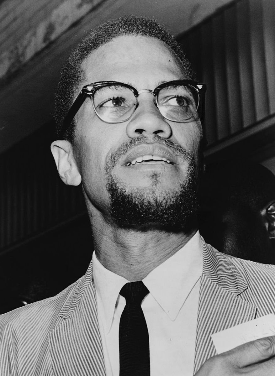 Malcolm X in 1964, shortly after his conversion to Sunni Islam and pilgrimage to Mecca.  The trip altered his views. He changed his ideas on political violence, and decided that the differences between races could be resolved through Islam
