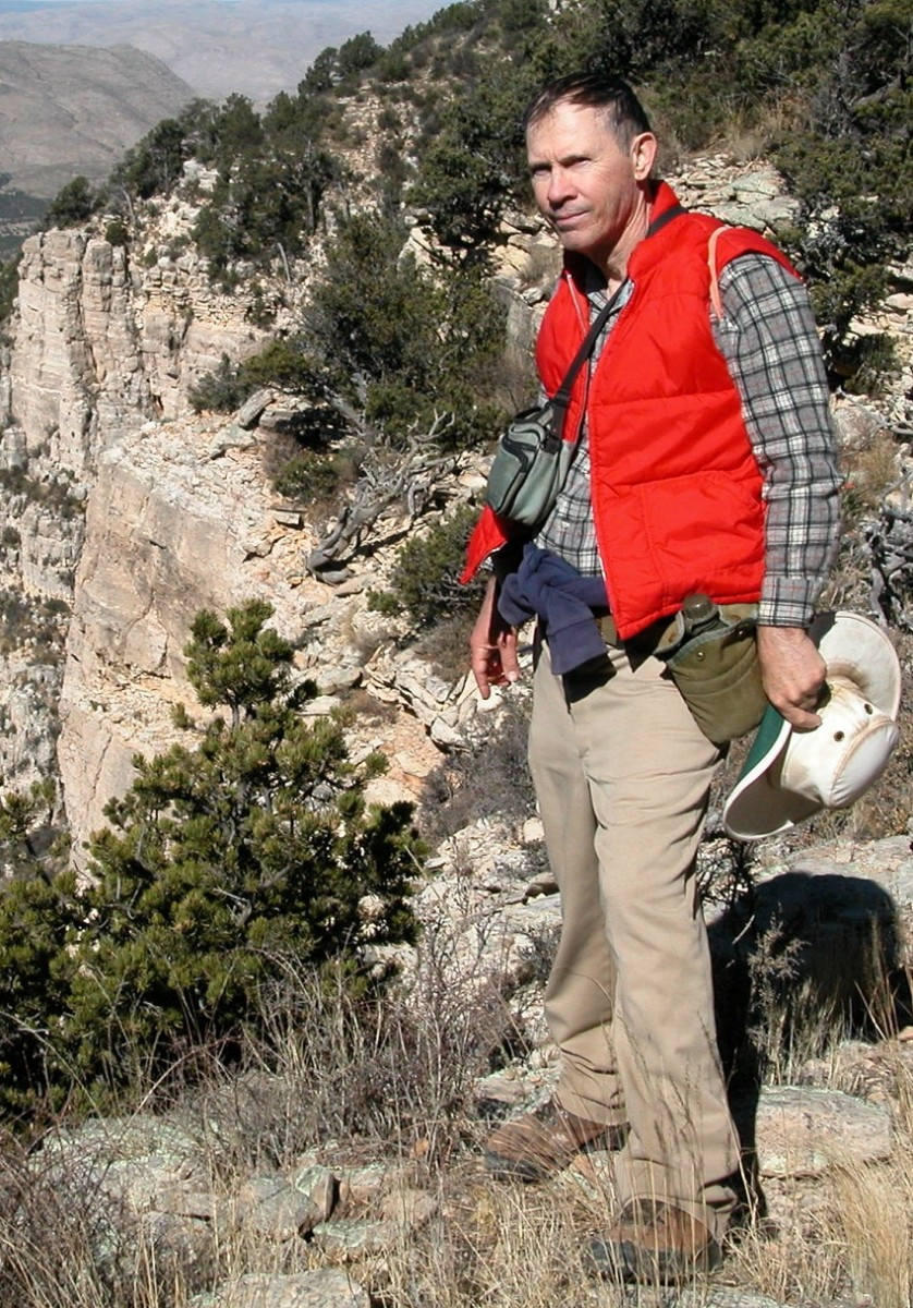 Western writer shown in Guadalupe Mountains, scene of one of his books.