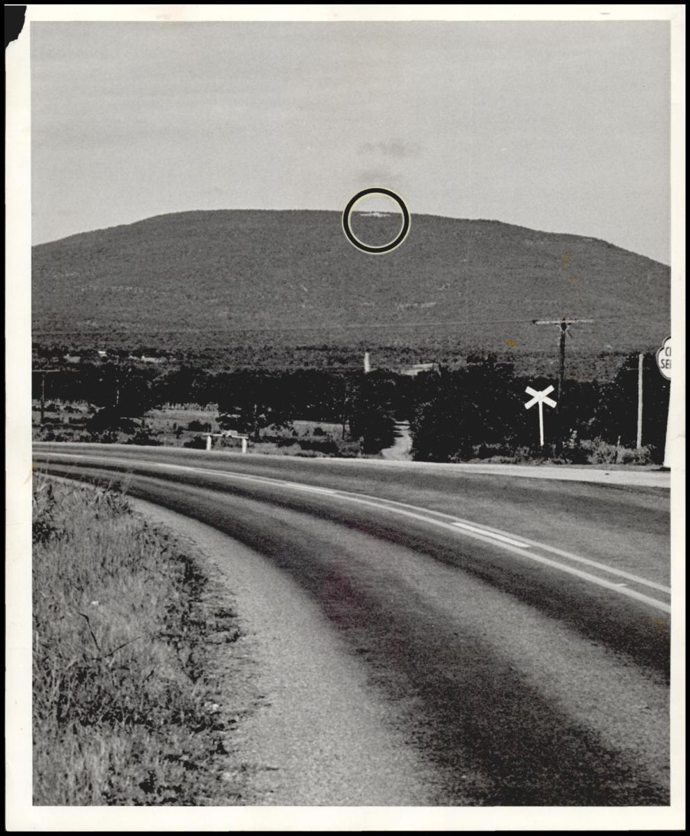 Seen for miles around the area of Poteau where President Kennedy is a visitor this weekend is this tiny speak on top of Mount Cavanal.  Photo taken in 1963.