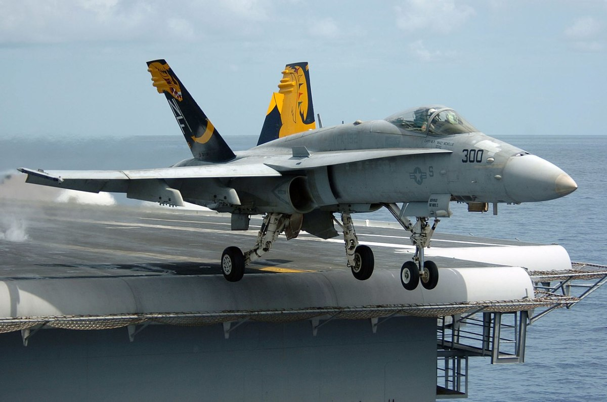 Typical legacy Hornet launching from an aircraft  carrier