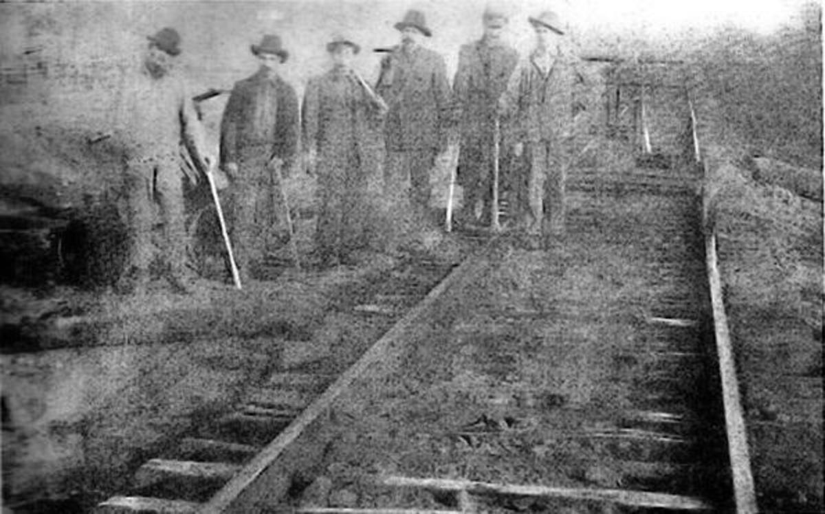 Men working on laying tracks for the KCS railroad..