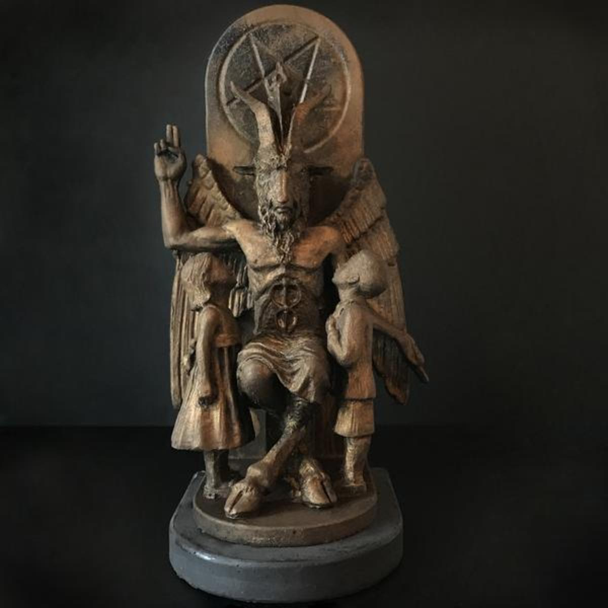 The statue of Baphomet features two young children seeking knowledge..