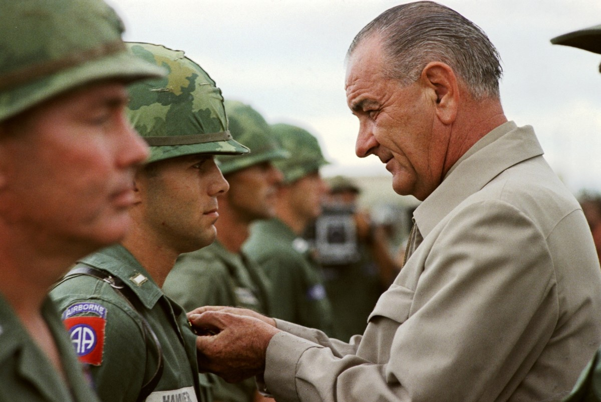 President Lyndon B. Johnson awards the Distinguished Service Cross to First Lieutenant Marty A. Hammer, in Vietnam.