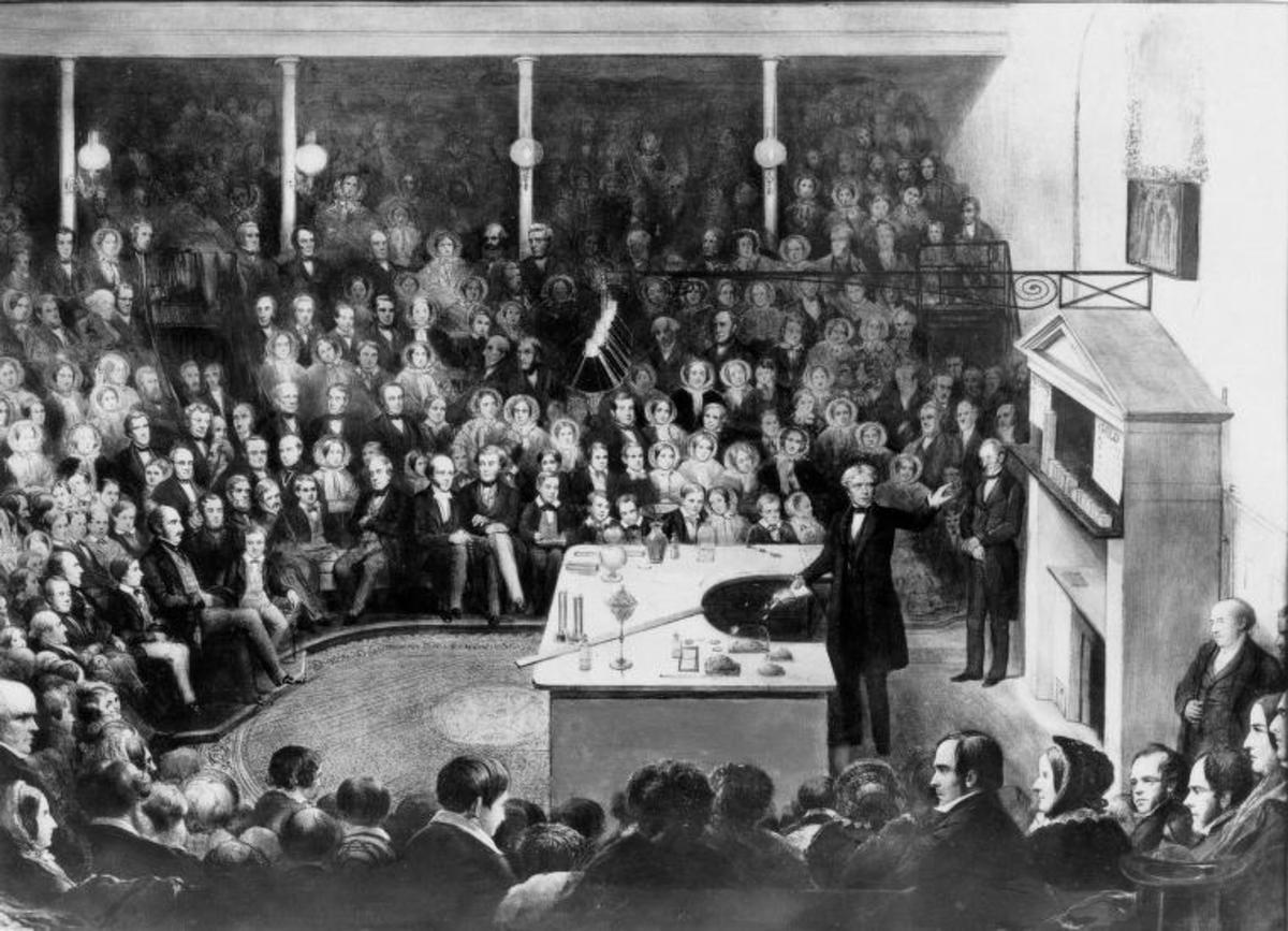 Faraday shown delivering the British Royal Institution's Christmas Lecture for Juveniles during the Institution's Christmas break in 1856