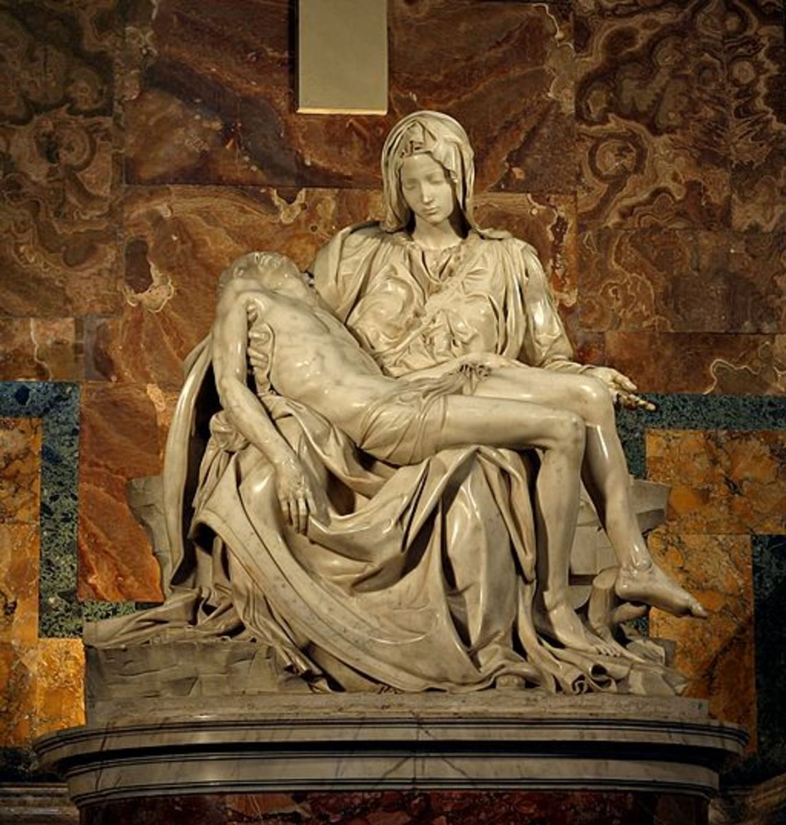 "Michelangelo's Pietà in St. Peter's Basilica in the Vatican. Maurya's mourning in ""The Riders to the Sea"" becomes an evocation of Pieta"
