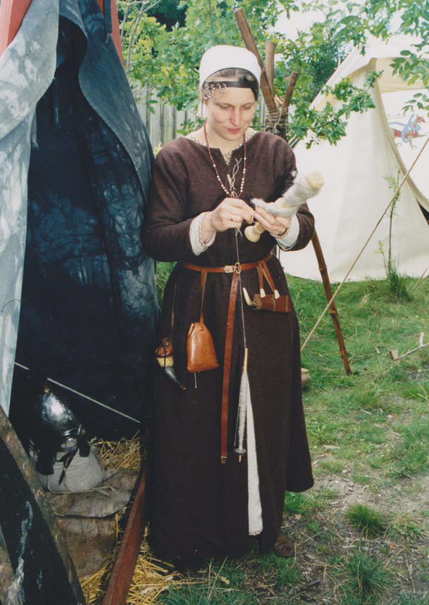 """Viking female a reenactor using the drop spindle in Holland"" by Peter van der Sluijs, 2013"