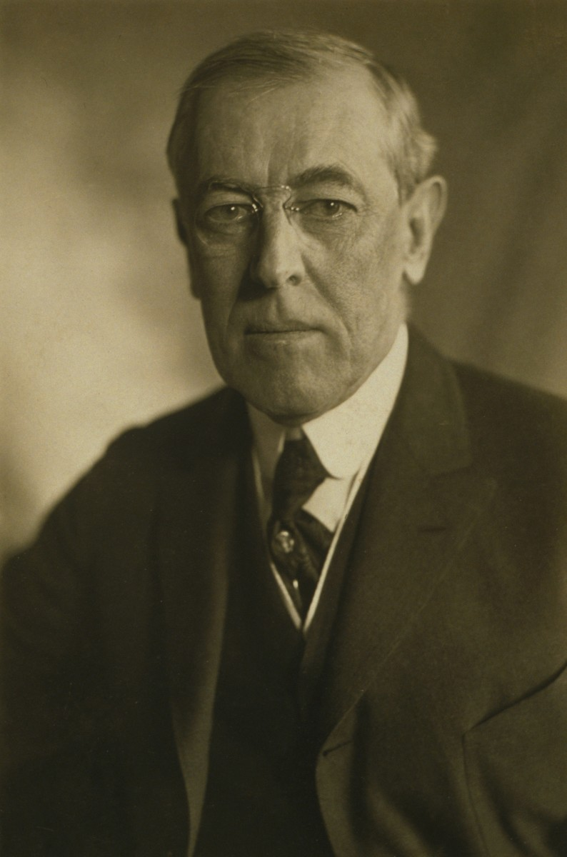 American progressives like Woodrow Wilson believed that American government experts should abandon some of its constitutional principles like that of national independence.