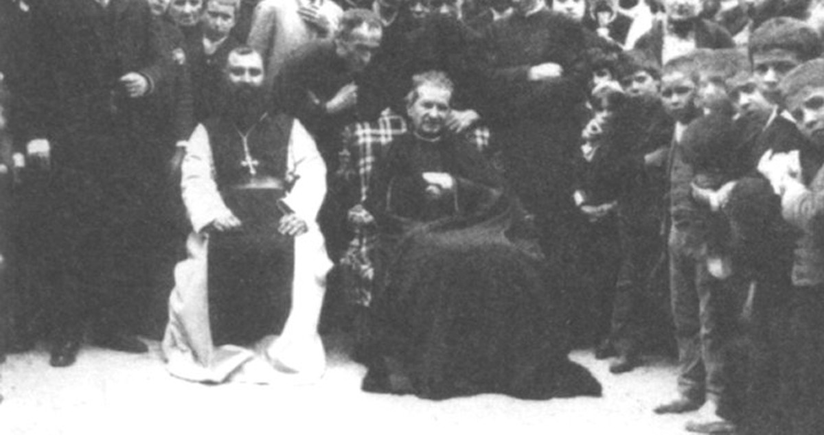 Don Bosco, near the end of his life, with persons who would help carry on his work.